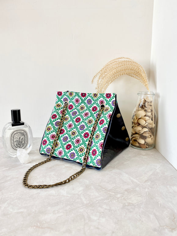 Black textured leather button cube bag - green flower tiles
