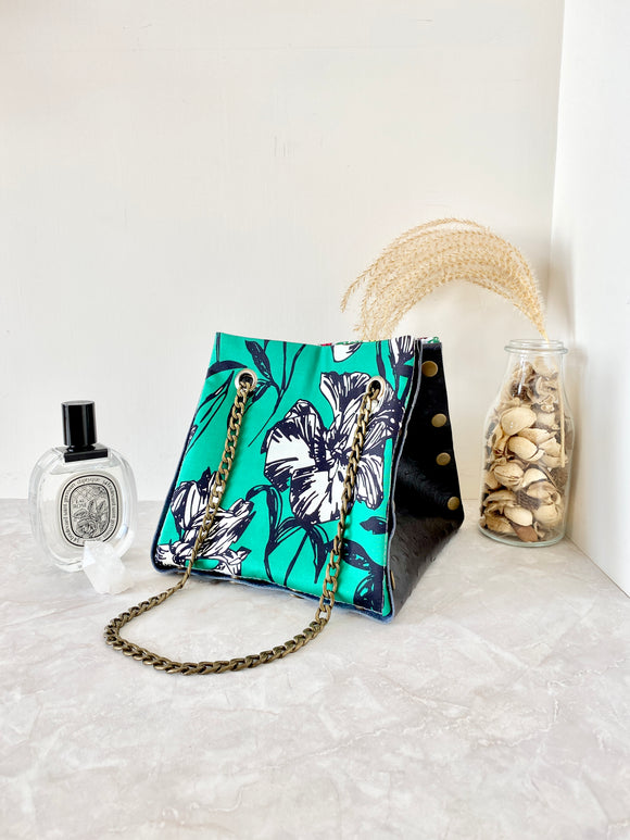 Black textured leather button cube bag - green floral sketch