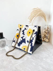 Black textured leather button cube bag - sunflowers