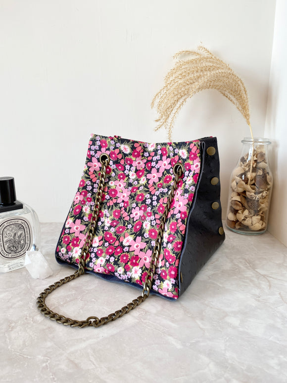 Black textured leather button cube bag - red floral