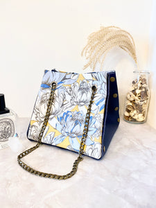 Blue leather button cube bag - lotus flowers