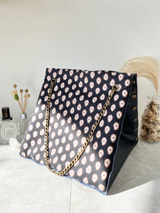 Black textured leather button cube bag - paisley print