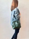 Green leather bucket bag with chevron lining