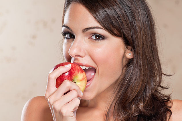 Gorgeous woman taking a bite out of an apple