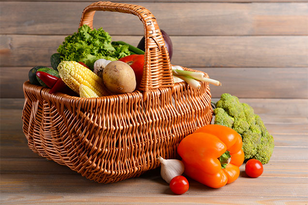 Photo of a basket containing organic vegetables