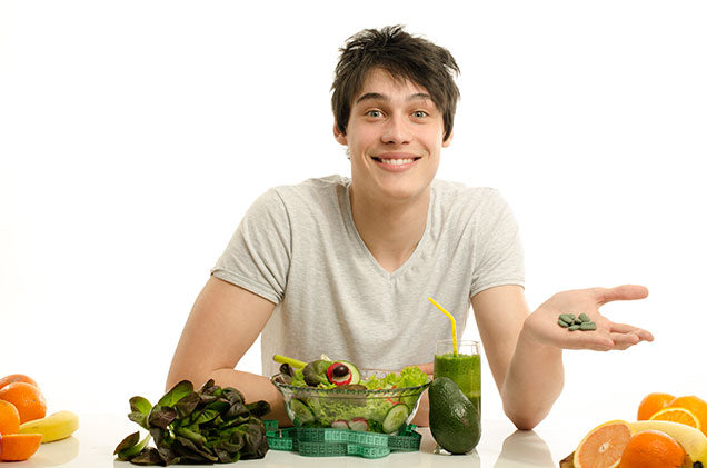 Photo of man eating healthy vegetables