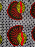 african fabric with feathered cowrie shells