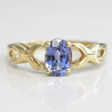 14K Yellow Gold Oval Tanzanite with Braided Criss-Cross Infinity Band Ring