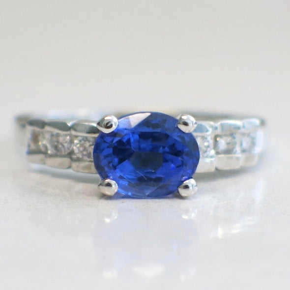 18K White Gold Tanzanite Set East to West With Diamond Accented Band
