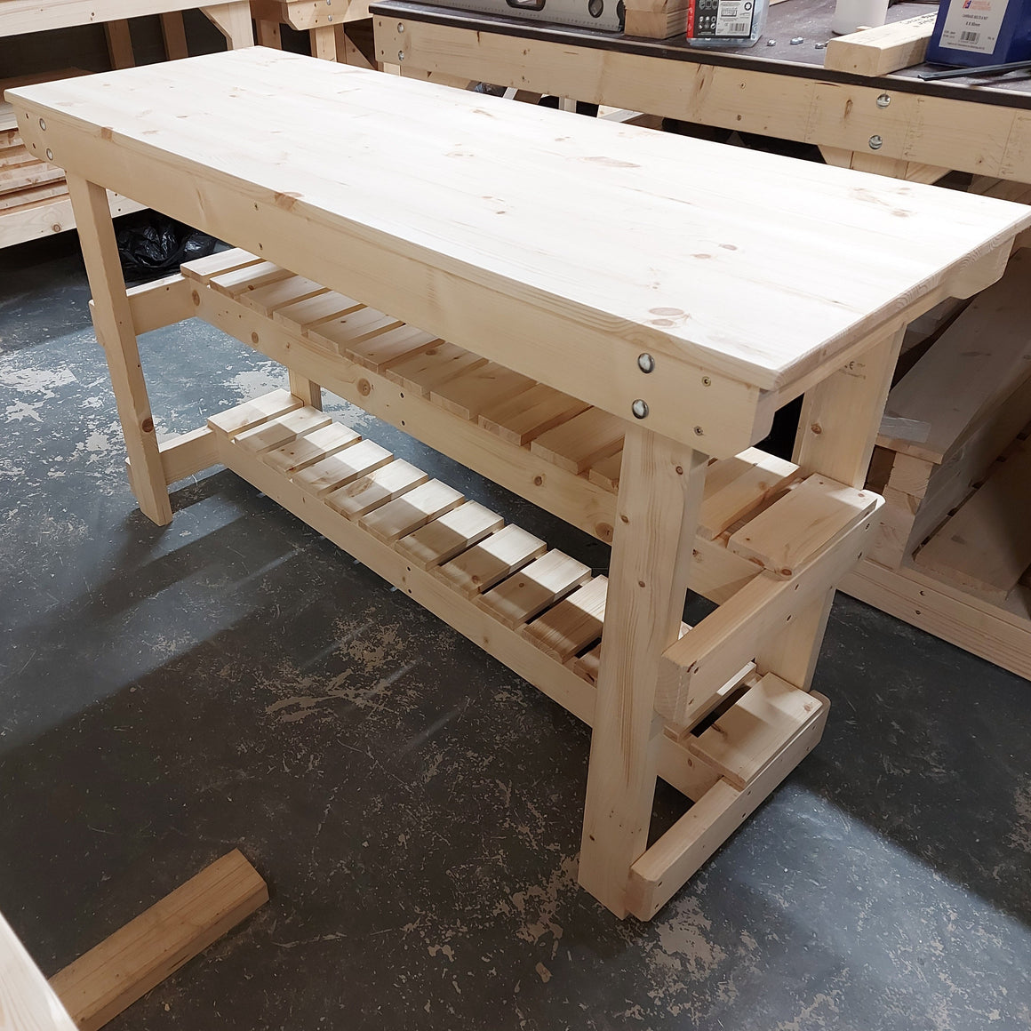 wooden workbench with recessed shelf
