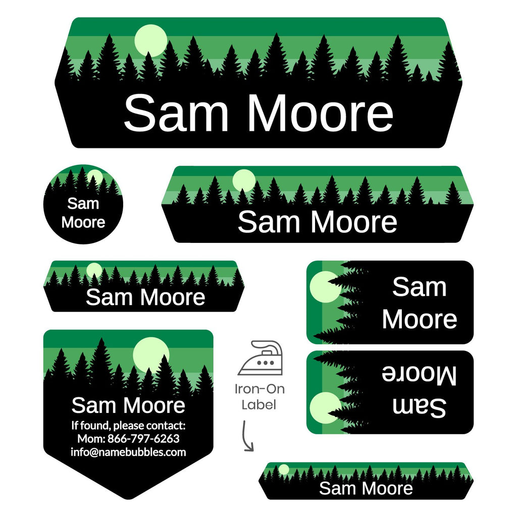 overnight camp labels of various shapes and sizes with forest silhouette and sky design