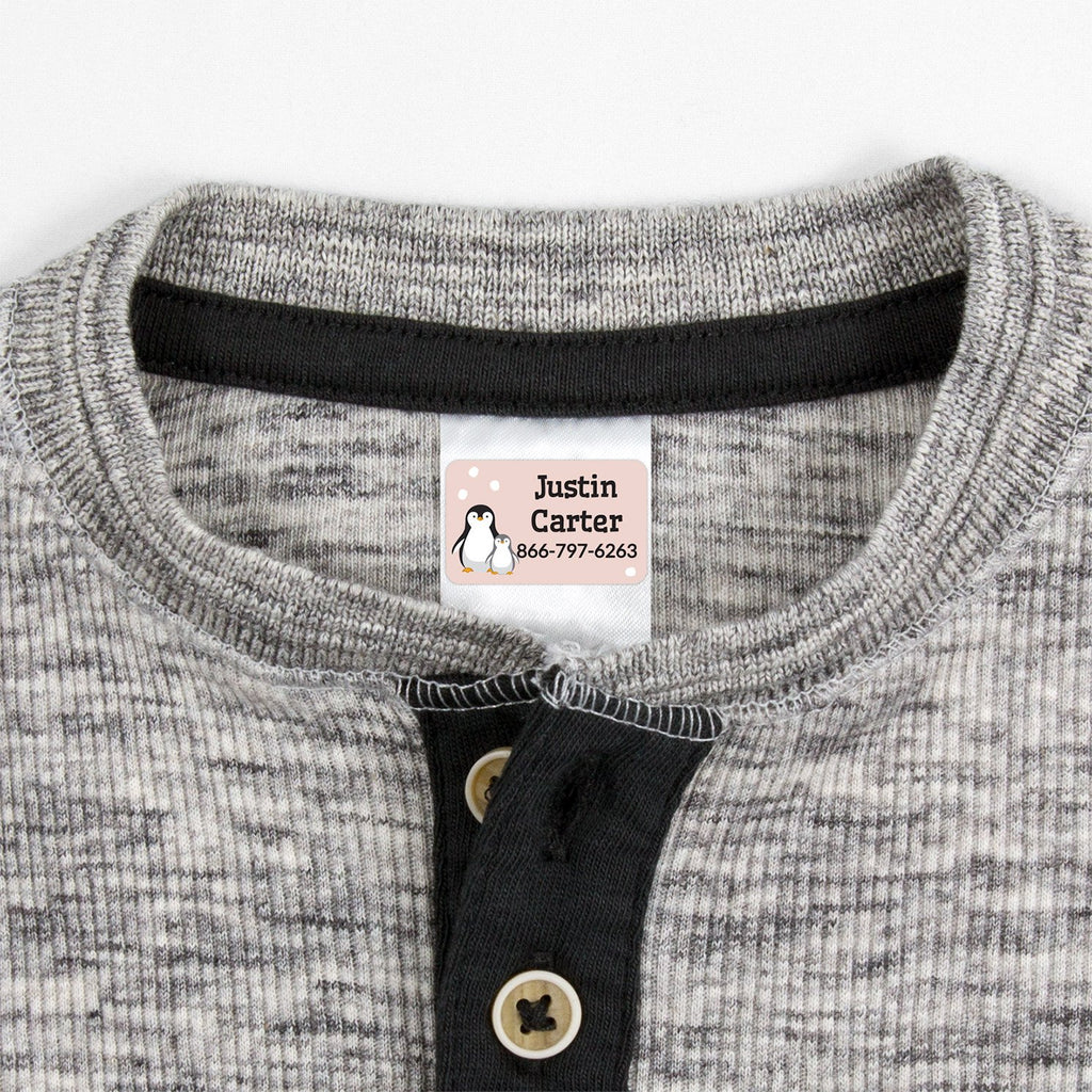 contact clothing labels with a pair of penguins - _Penguins_Cream
