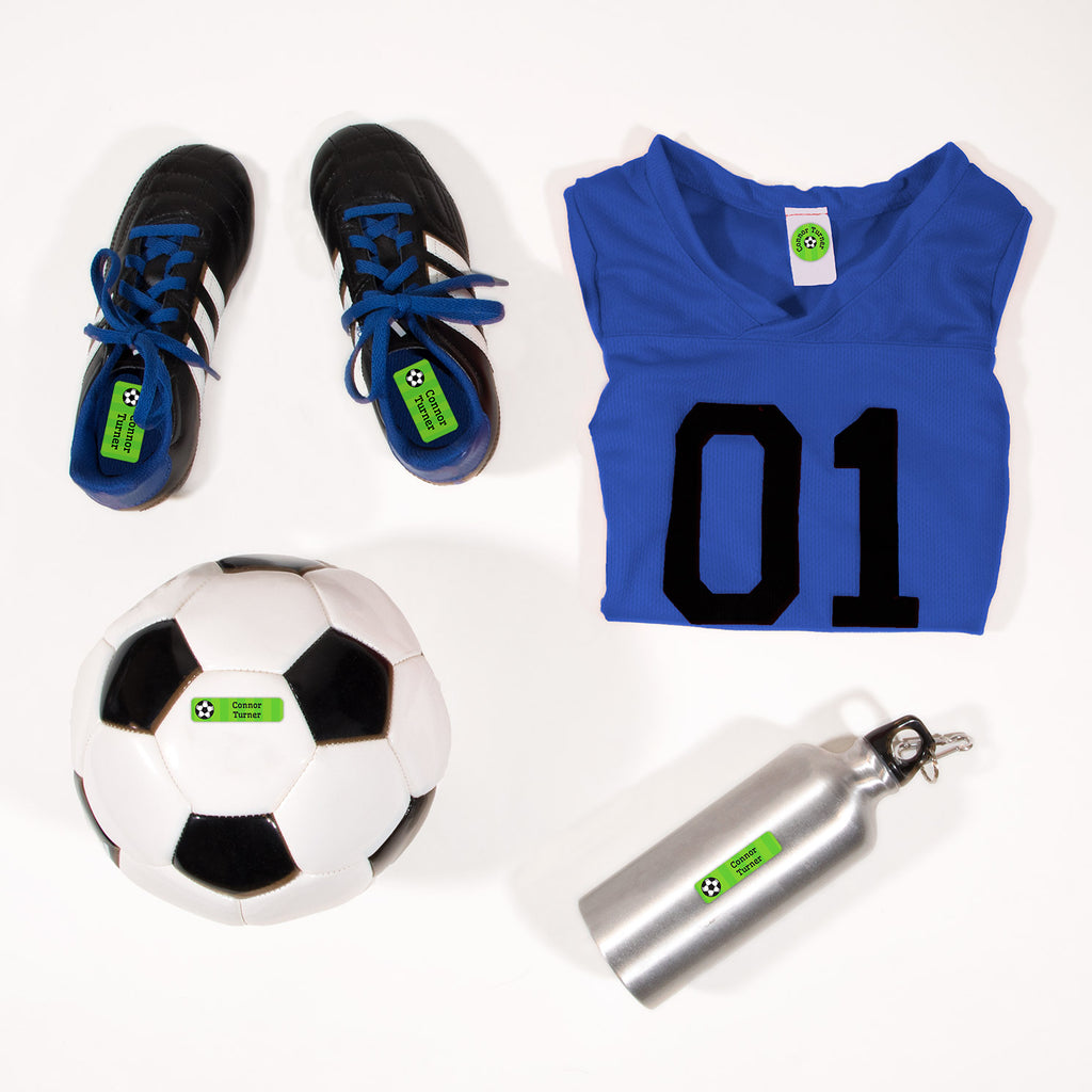 a mix of dishwaster and laundry safe labels featuring a soccerball on a striped green background - Soccer