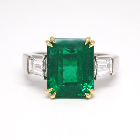 double prong setting custom emerald and diamond ring