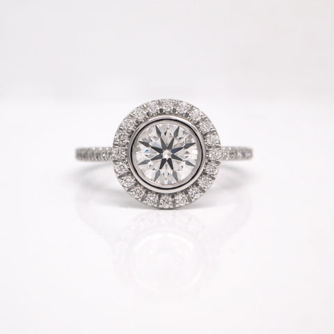 custom bezel set diamond halo engagement ring
