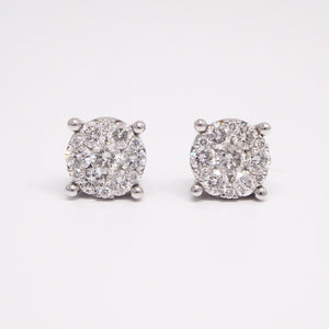18K white gold diamond earring studs with 26 brilliant-cut diamonds weighing a total of 1 carat invisible set in delicate filigree baskets.