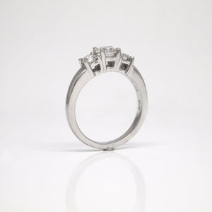 Platinum 3-stone diamond engagement ring with diamonds weighing a total of 1.02 carats.
