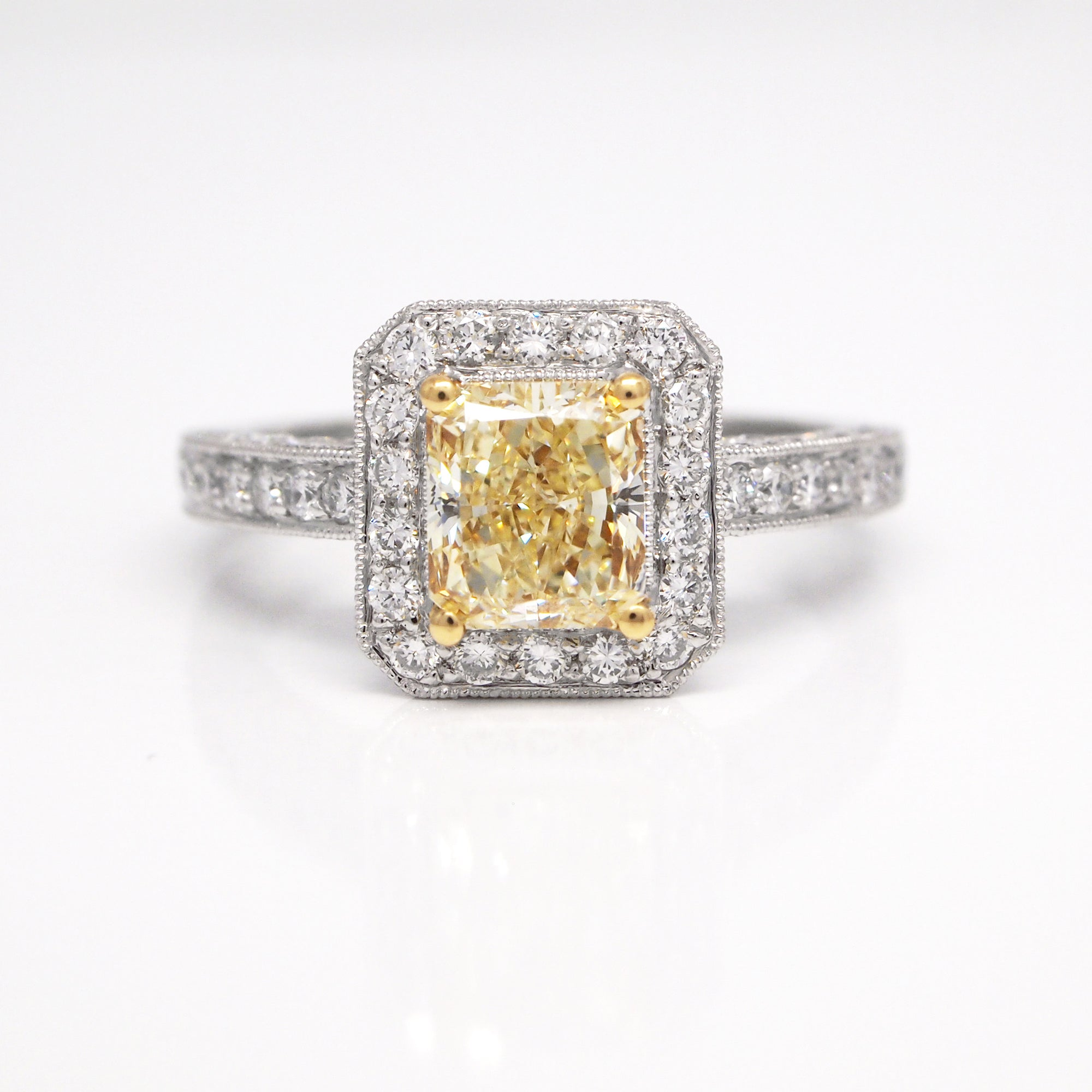 Platinum and 18K white gold pave engagement ring with one 1.39 carat radiant-cut yellow diamond (SI1), and round white diamonds