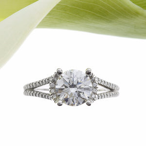 Platinum Halo Split Shank Diamond Engagement Ring With A Round Diamond Centerstone and Round Diamonds