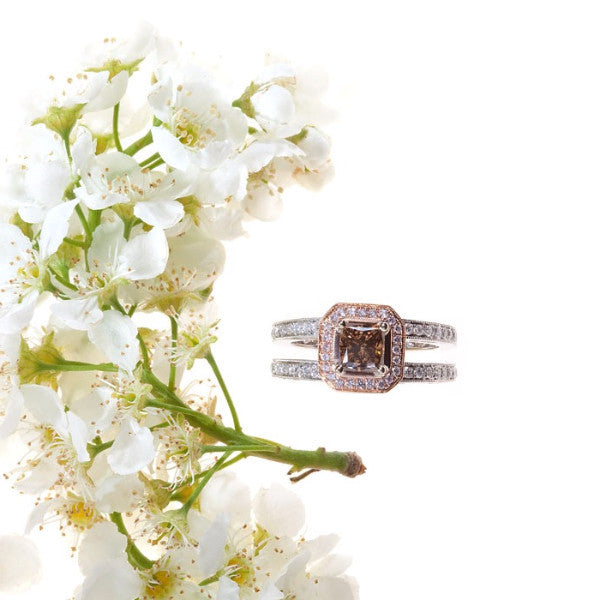 white and rose gold double shank engagement ring with cognac, pink, and white diamonds
