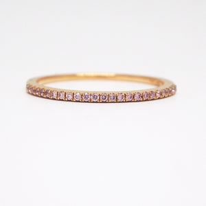 18K rose gold wedding band with prong-set pink diamonds weighing a total of 0.11 carats.