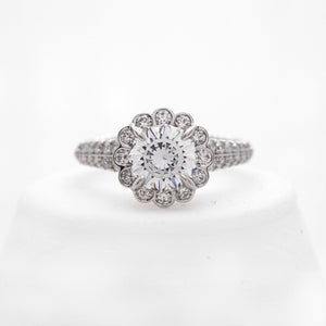 Platinum diamond ring with round brilliant diamonds weighing a total of 0.69 carats.