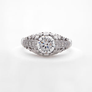 Platinum diamond engagement ring featuring round brilliant diamonds weighing a total of 0.21 carats.