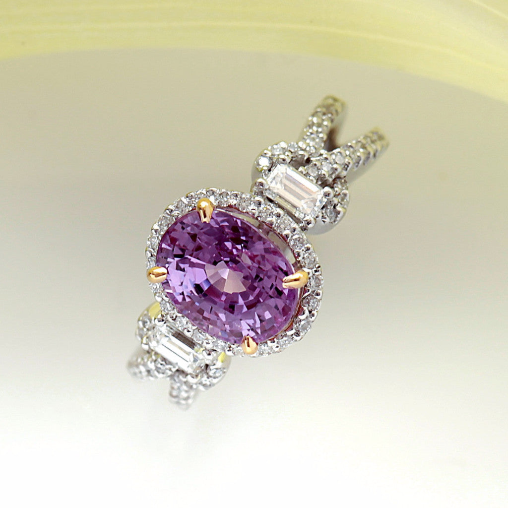 White Gold Ring with One Intense Pink Oval Sapphire in Yellow Gold Prongs, Baguette Diamonds, and Micro Pave Set Diamonds