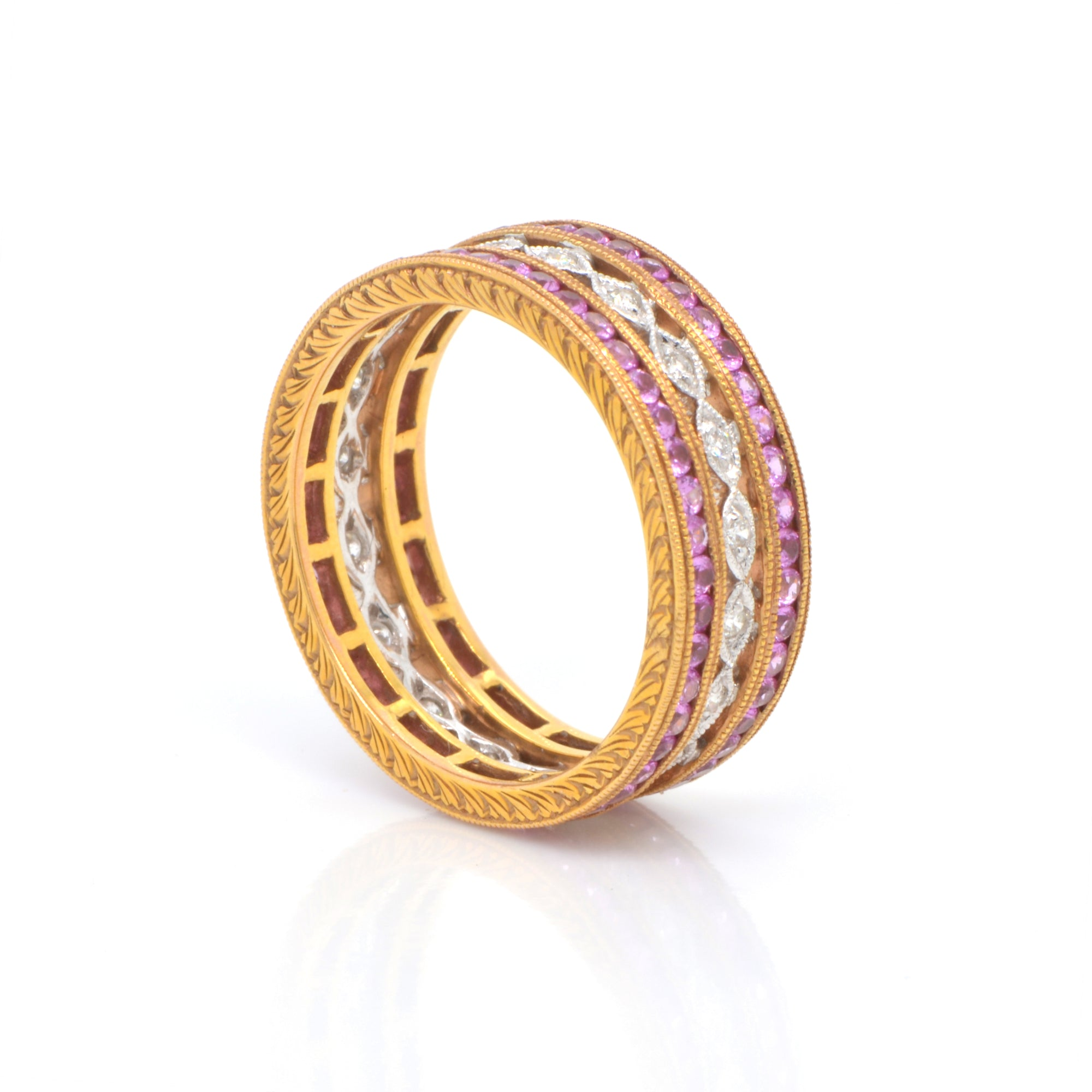 18K rose and white gold eternity band featuring rows of pink sapphires (1.35ctw) in rose gold, and round brilliant diamonds (0.14ctw) on a white gold band in a full eternity design.