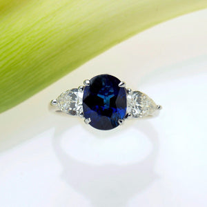 White Gold Three-Stone Ring with One Certified Natural Blue Sapphire and Two Pear Shaped Diamonds