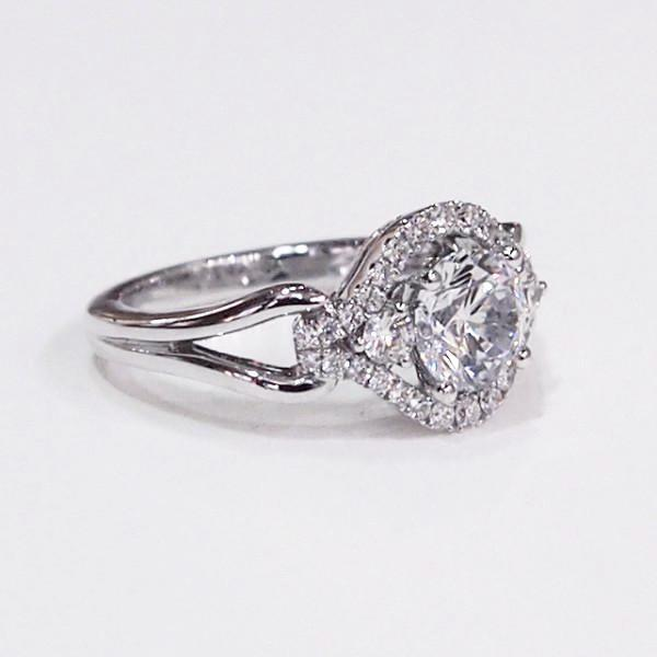 14K white gold semi-mount engagement ring with a halo containing 32 diamonds