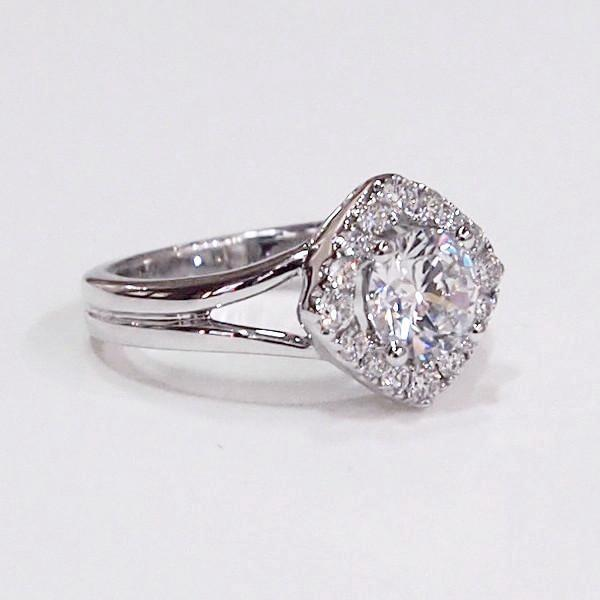 14K white gold semi-mount engagement ring with a marquis-shaped halo containing 16 diamonds