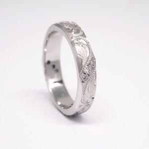Platinum 4mm hand-engraved ring with diamonds weighing a total of 0.12 carats.