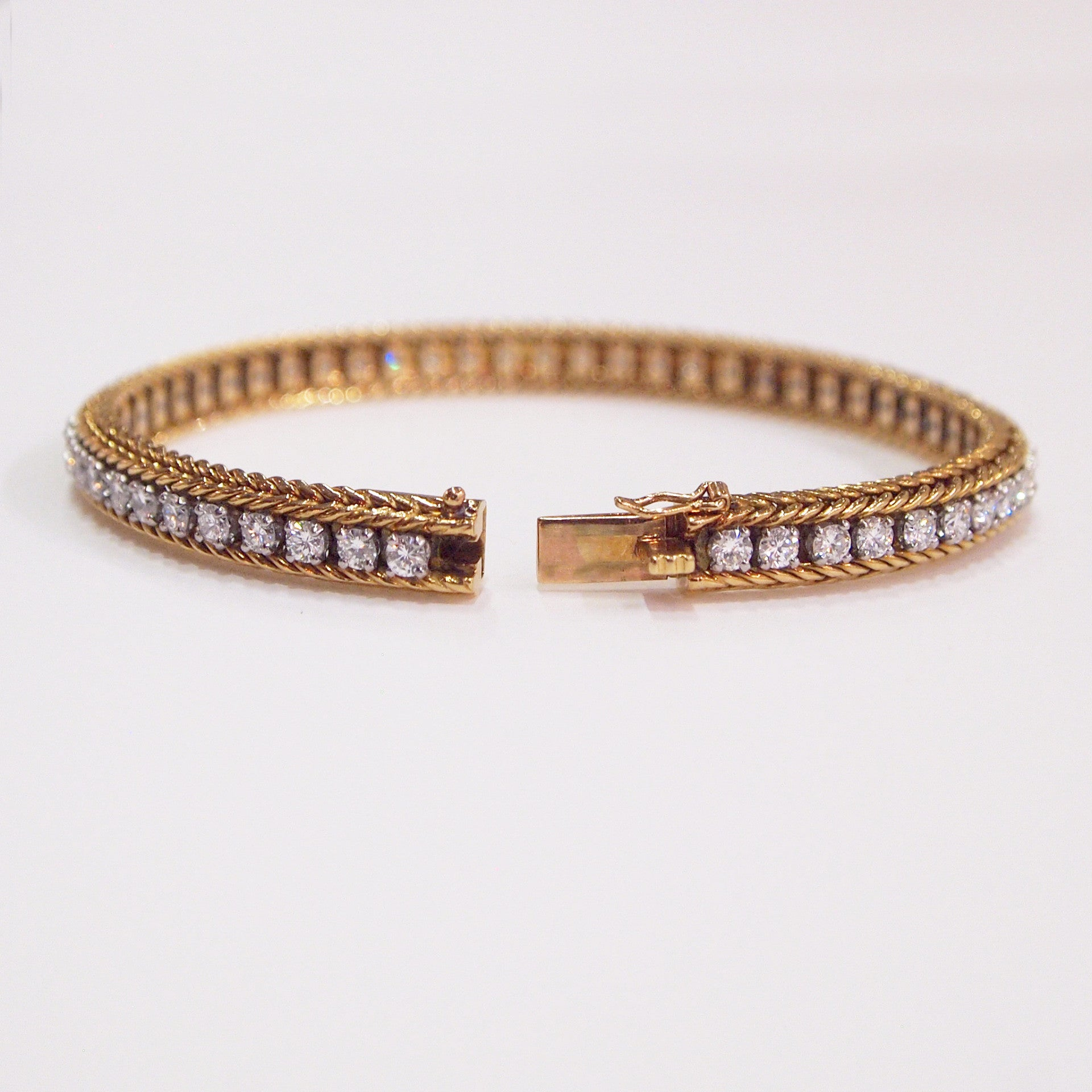 18K yellow gold and platinum antique Oscar Heyman design bracelet with 54 round diamonds (G/H color, VS2 clarity)