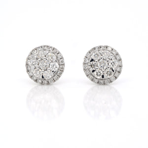 14K white gold diamond earrings featuring round brilliant diamonds weighing a total of 0.50 carats.
