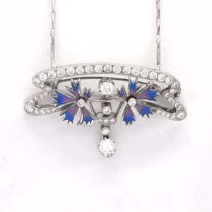 Nouveau 1910 18K white gold diamond pendant/brooch set with 48 round diamonds with a total carat weight of 1.95 carats.