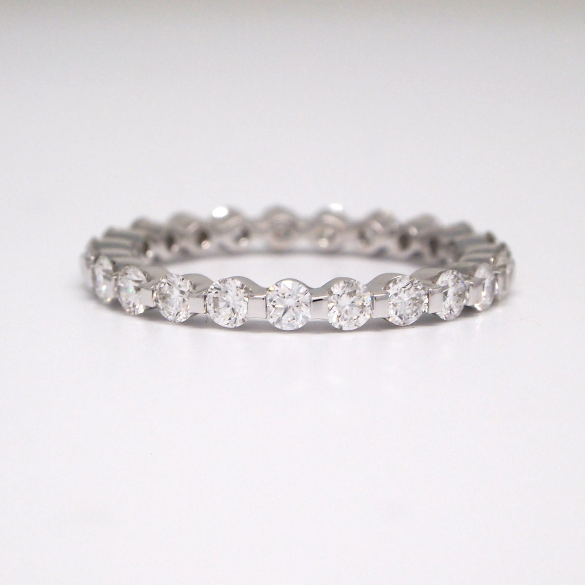 18k white gold diamond eternity band set with 23 round brilliant diamonds weighing a total of 1.30 carats.