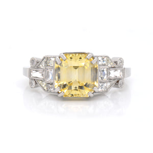 Antique platinum yellow sapphire and diamond engagement ring featuring one 3.92 carat Asscher-cut yellow sapphire, and special-cut antique baguette white diamonds and round diamonds weighing a total of 0.92 carats. Judith Arnell Jewelers.
