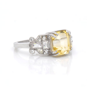 Judith Arnell Jewelers. Antique platinum yellow sapphire and diamond engagement ring featuring one 3.92 carat Asscher-cut yellow sapphire, and special-cut antique baguette white diamonds and round diamonds weighing a total of 0.92 carats.