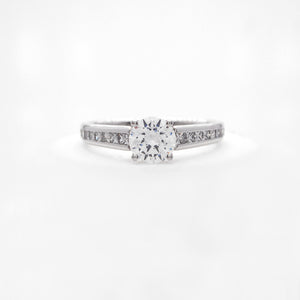 Platinum diamond engagement ring featuring princess cut diamonds weighing a total of 0.47 carats.