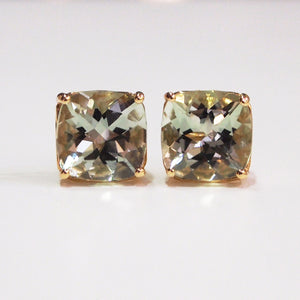 14K yellow gold four-prong stud earrings with two cushion-cut green amethysts