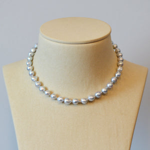 Pearl strand necklace featuring silvery-blue baroque pearls (8mm - 9mm) and a 14K rose gold clasp.
