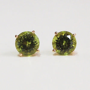 14K yellow gold earrings with two peridots
