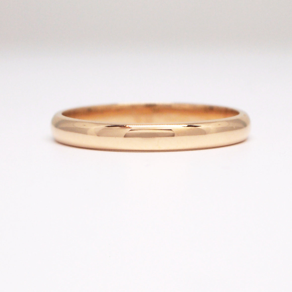 18K yellow gold 2.5mm half round wedding band.