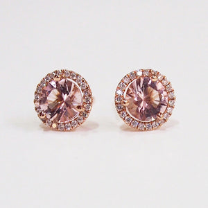 14K pink gold earring studs set with two round morganites weighing a total of 1.34 carats, and round brilliant diamonds