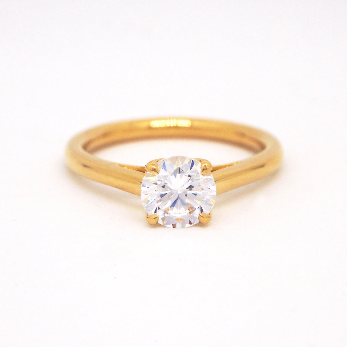 Point of Love 18K yellow gold solitaire engagement ring with a diamond 'point' weighing 0.09 carats.