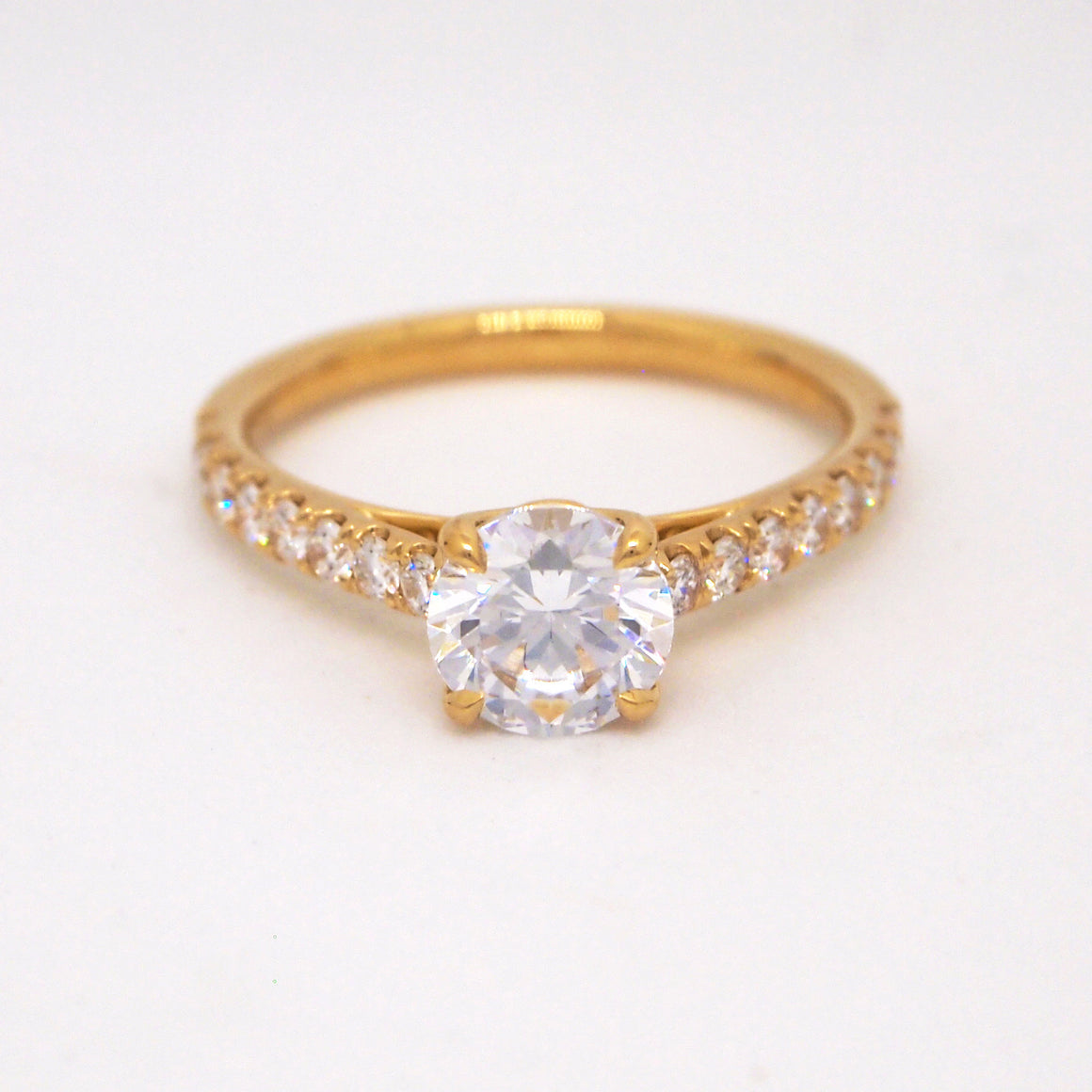 Point of Love 18K yellow gold engagement ring with 0.40cts of brillliant cut diamonds and one ruby weighing 0.12cts