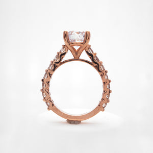 14K rose gold diamond engagement ring with round brilliant diamonds weighing a total of 1.40 carats.