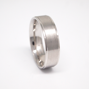 14k white gold 6mm man's wedding band featuring a satin center with bright rolled edges.