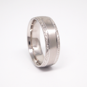 14k white gold 7MM man's wedding band featuring a satin center with hand engraved edges.